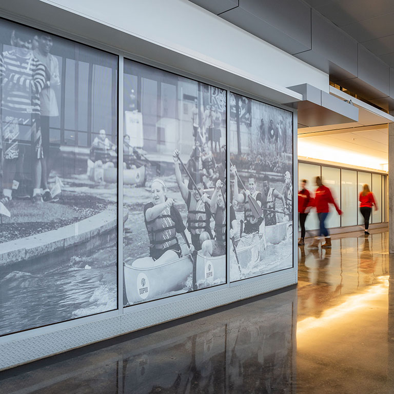 A mural in the Campus Center on the IUPUI campus shows participants in the IUPUI regatta