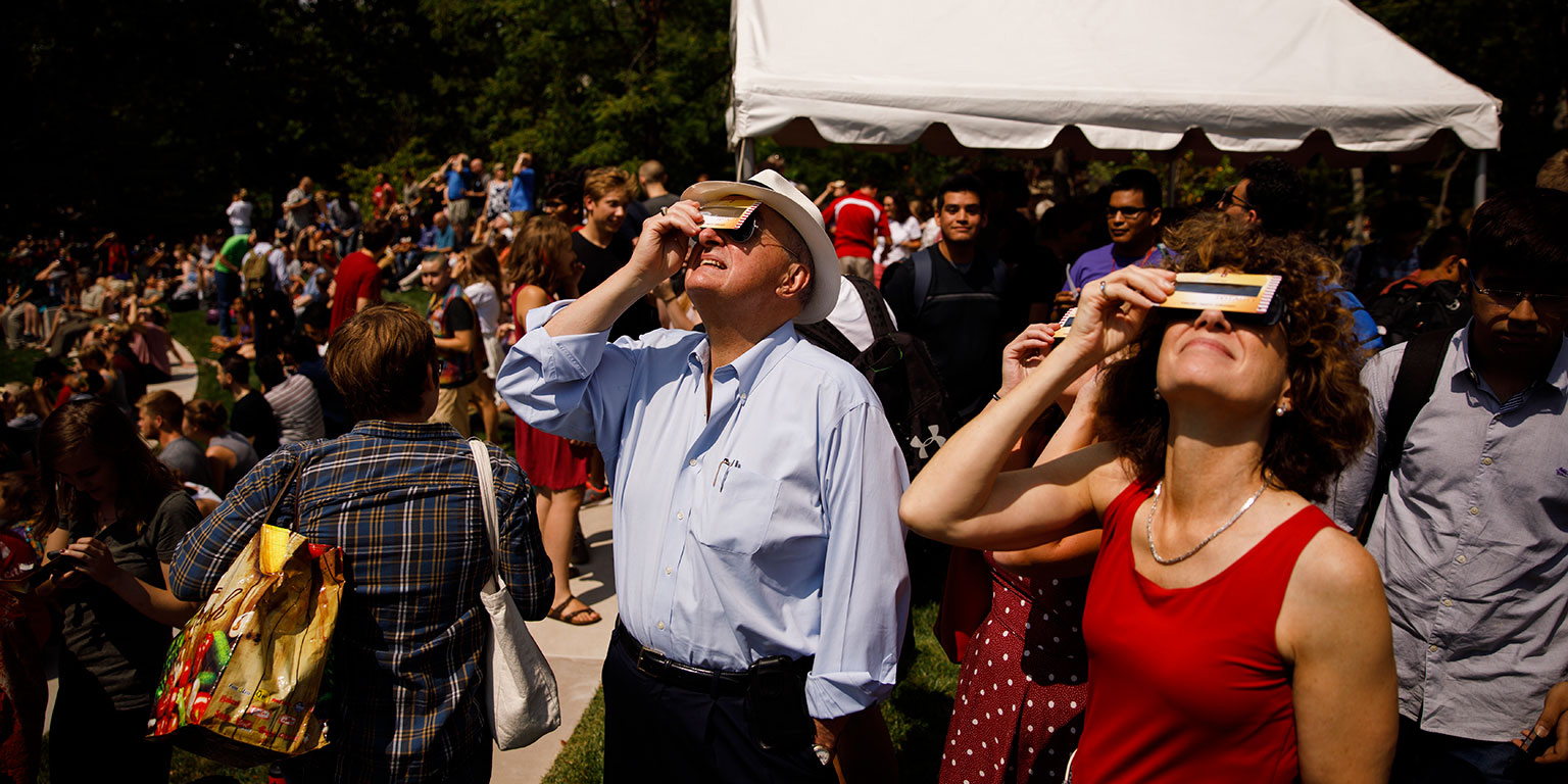 A large crowd watches the August 2017 solar eclipse from the Conrad Prebys Amphitheater on the IU Bloomington campus