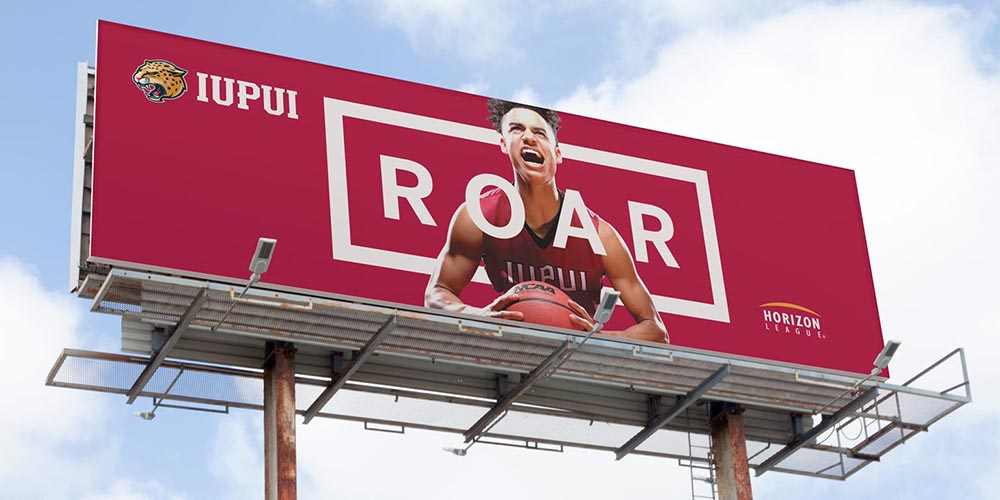 "Billboard for IUPUI ROAR campaign that has a basketball player making a ""roaring"" face."