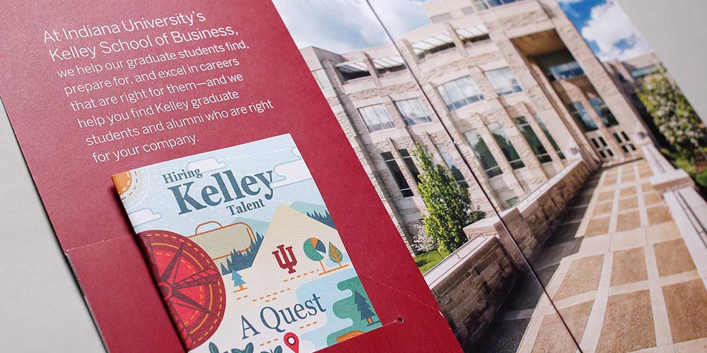 "Brochure titled ""Hiring Kelley Talent"" with Kelley School of Business building reflecting off the window in the background."