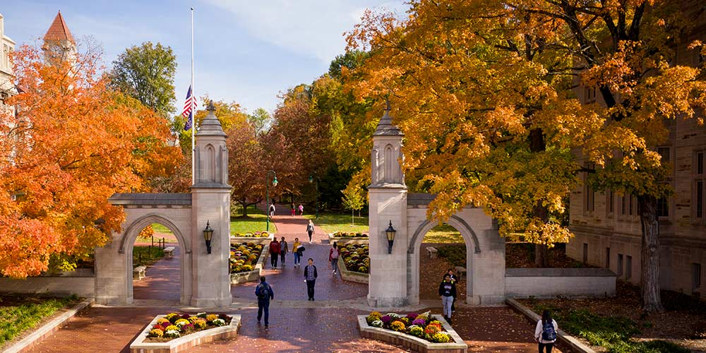 Sample gates in the fall with orange and yellow leaves during the daytime.