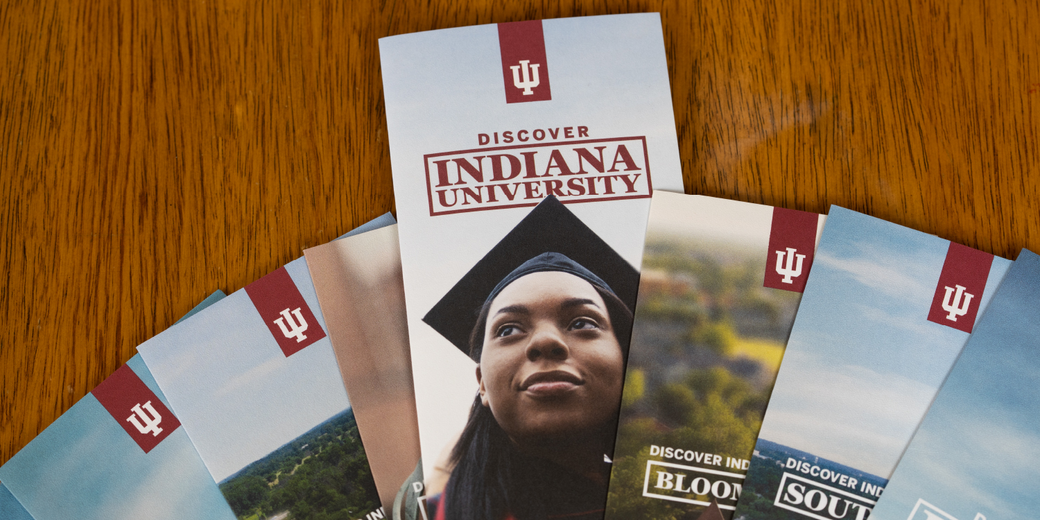 Collection of brochures on each of IU's campuses fanned out on table