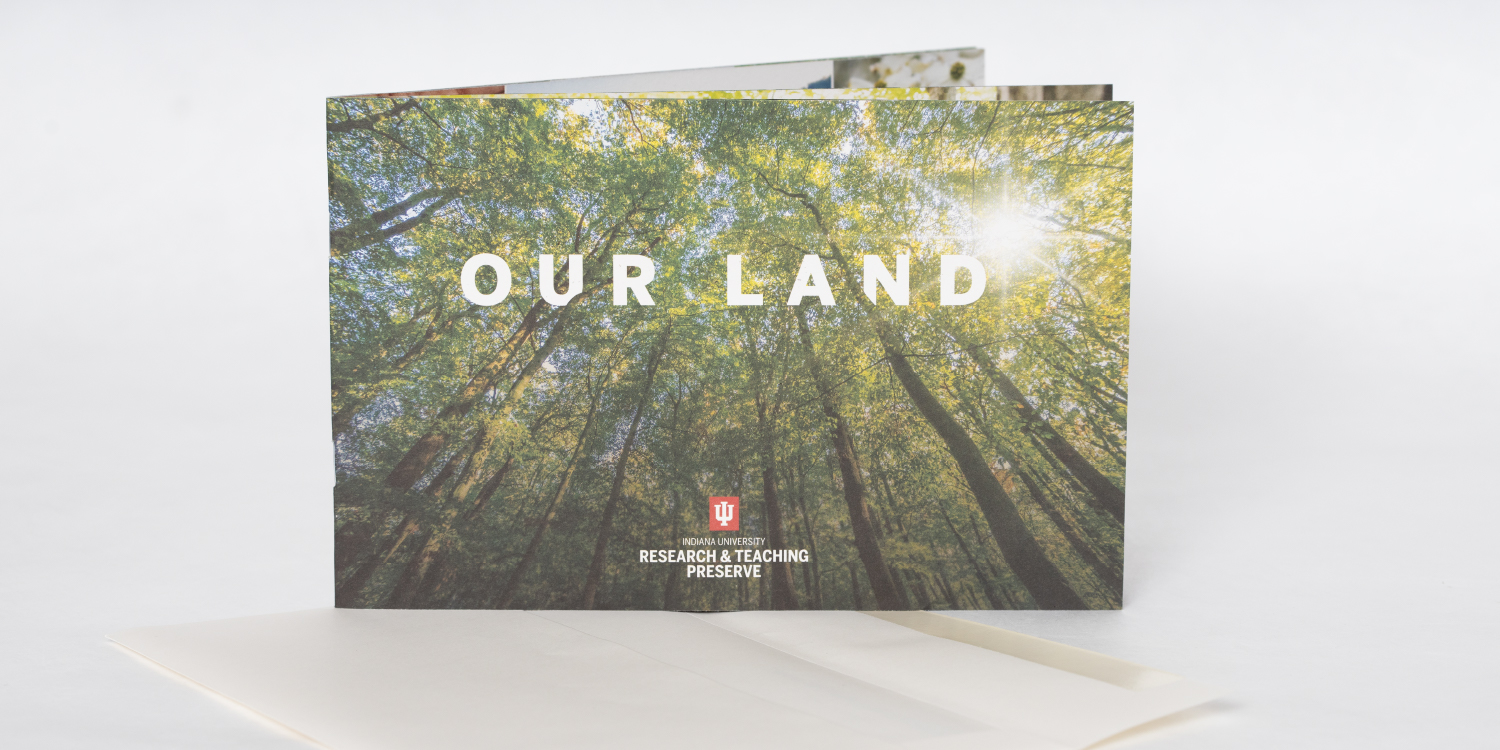 """Booklet brochure titled """"Our land"""" with mailer envelope"""